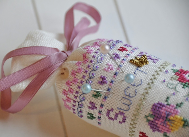 like needle rolls...love the words amongst the patterns and motifs