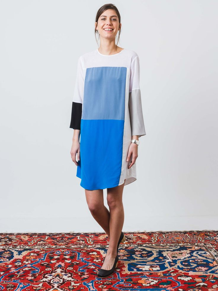 Fun color block dress in mixed materials. The main body of the dress is done in a crisp white cotton. The accent pieces are done in silk. Features a rounded neck and a curved hem. - Bracelet sleeves -
