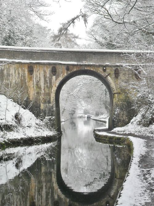 Canal bridge and reflections in the snow, Shropshire Union Canal, Staffordshire, England