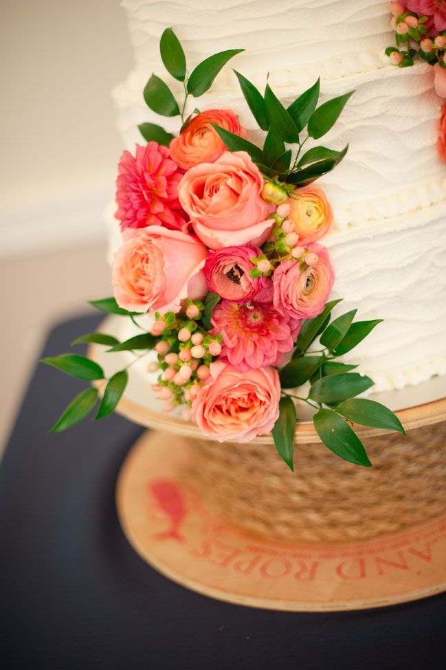 Fresh flower accents, wedding cake | Coral & Navy Vintage Inspired Nautical Wedding At The Ribault Club Jacksonville Florida | Photograph by Britney Kay Photography   http://storyboardwedding.com/vintage-nautical-wedding-ribault-club-jacksonville-florida