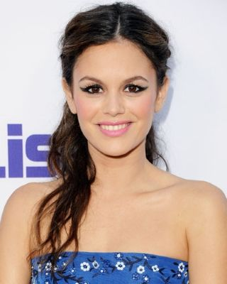 "Rachel Bilson's half-up braided hairstyle is a perfect option during those final humid days of summer. After wrapping Rachel's hair around a curling iron, hairstylist Davy Newkirk loosened the curls with a blow dryer. ""Coming together in the center with two braids, I pinned the braids under the back section of the hair."" Next, ""I pulled the side sections of hair back and secured them underneath to give the illusion of a ponytail."""