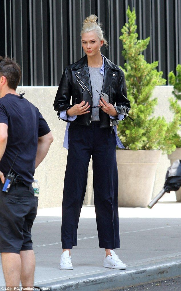 Switch it up: To switch styles up, the young starlet threw on a black leather motorcycle jacket with a pair of black pants