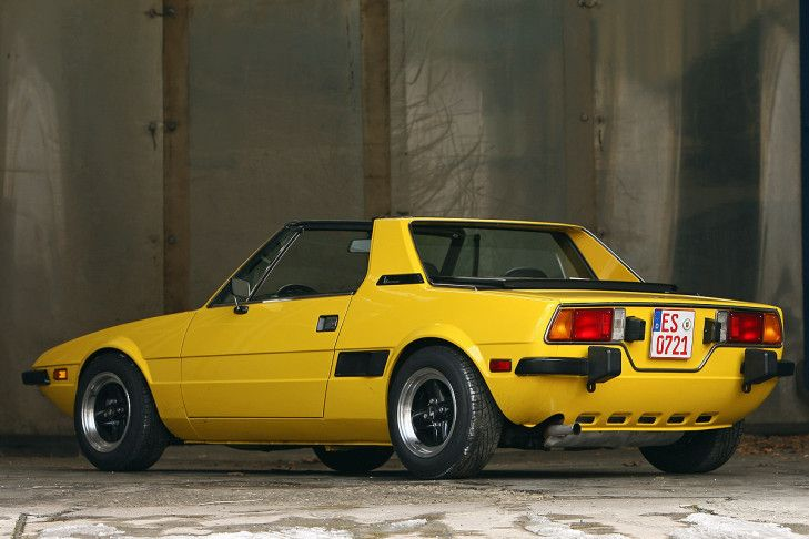 Probably my favorite of the mid-engined runabouts, based on transverse drivetrains from front-drive cars (You know, because I have a favorite one-of-those.), Fiat's delicious little X1/9.