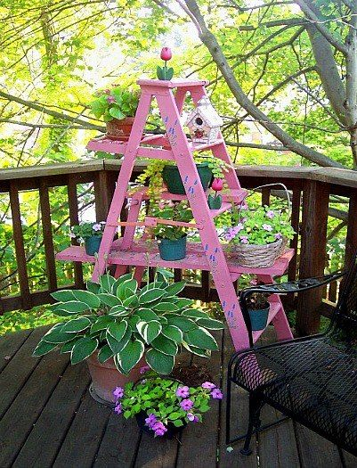 Painted PINK ladder makes a FUNCTIONAL vertical GARDEN! i love this ideas