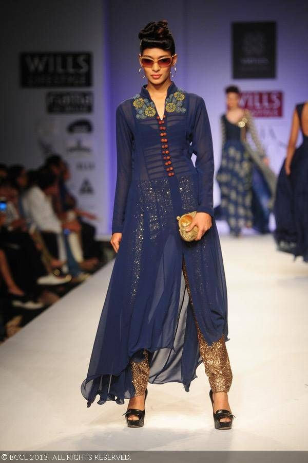 Nethra Radhuraman walks the ramp for fashion designers Ashish Viral and Vikrant on Day 5 of Wills Lifestyle India Fashion Week (WIFW) Spring/Summer 2014, held in Delhi.