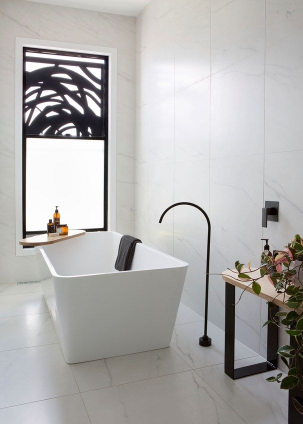 The deep freestanding bath and sculptural powder-coated spout from Highgrove Bathrooms are the stars of the room