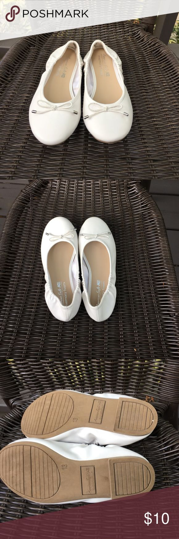 American Eagle girls white slip on shoes Very nice worn once slip on white shoes with elastic on sides, white bows on front, memory foam inside. No scuffs or stains American Eagle by Payless Shoes Dress Shoes