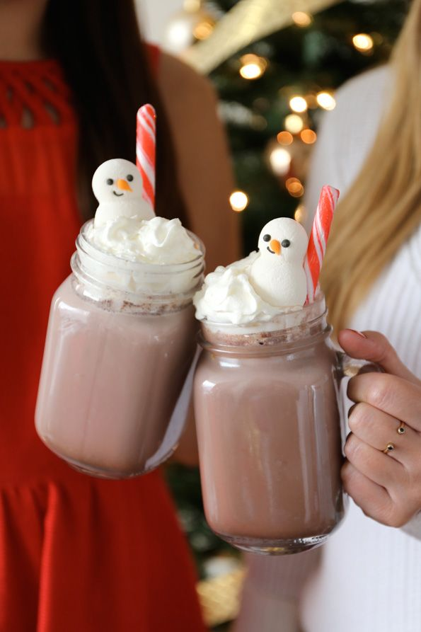 Serve hot cocoa for a sweet treat while decorating. We garnished ours with whipped cream, snowmen icing decorations and peppermint sticks.