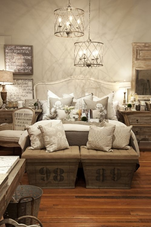 Bedroom in shabby chic neutrals. I love the huge night stands and the two square benches at the foot of the bed.