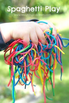 Playing with rainbow coloured spaghetti is a wonderful sensory activity for children of all ages, including babies - Laughing Kids Learn
