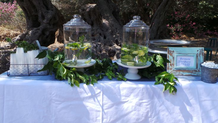 At a July wedding in an orchard in Naxos Greece you need some water! Created by Islandevents.gr