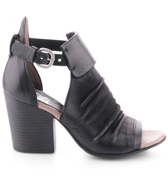 This chunky heel has some serious attitude. A buckled ankle strap and playfully wrinkled leather outer make for the perfect counterparts to this sassy spring look.