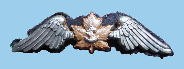 Royal Canadian Naval Air Service pilot wing 1918. Multipart construction, silver overlays over bronze and original cloth backer. Only 16 of these badges were released, intended for the remainder of the 1st class to graduate from MIT. They were numbered and matched to numbered officer cap badges, also multi-part construction