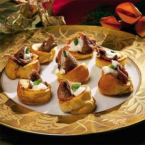 Bake your own Yorkshire puddings in a muffin tin and top each one with slices of perfectly roasted prime rib and a drizzle of horseradish sauce. These elegant and creative puddings are sure to delight your guests!