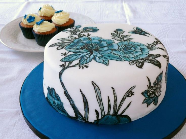 Black and blue hand painted floral design cake.