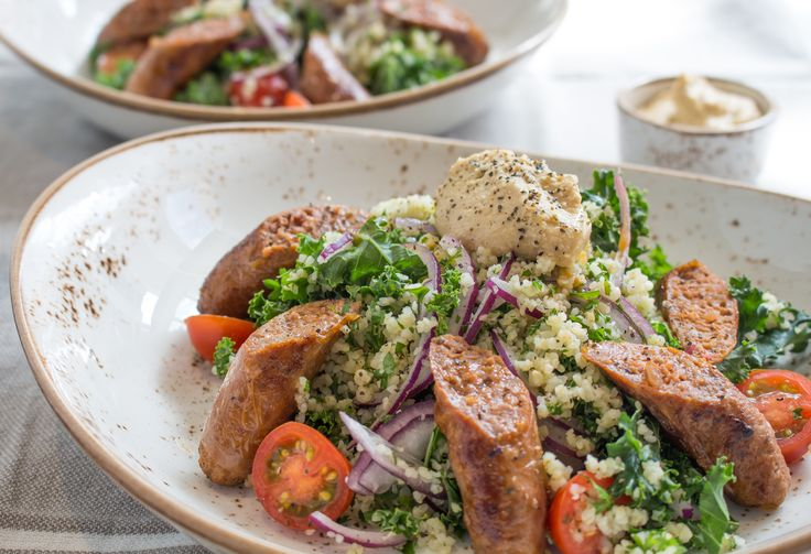 Tonight's dinner comes from the culturally rich shores of Lebanon! Featuring tasty merguez sausages on a bed of kale tabbouleh, with a generous dollop of authentic hummus