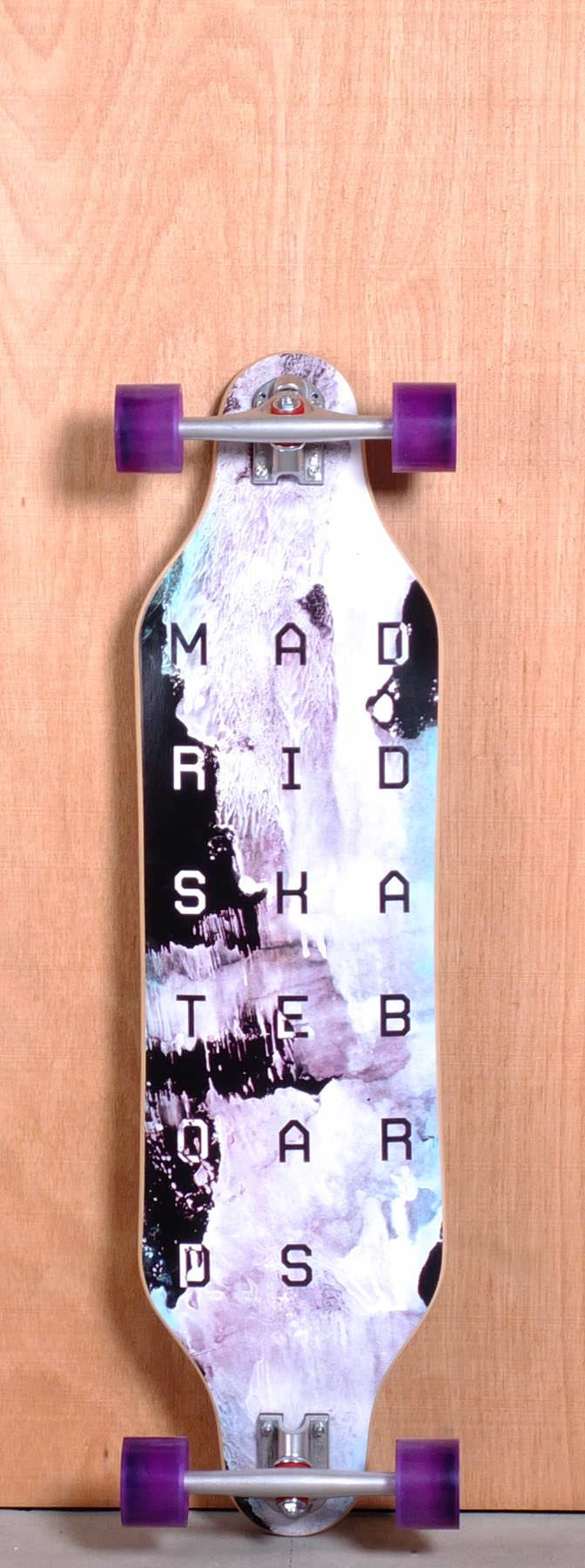 """The Madrid Paint Longboard Complete is designed for Cruising and Carving. Ships fully assembled and ready to skate!  Function: Cruising, Carving, Freeride  Features: Drop Down, Concave, Twin Tip, Wheel Cutouts  Material: 8 Ply Maple  Length: 37.375""""  Width: 9.375""""  Wheelbase: 29.5""""  Thickness: 7/16""""  Hole Pattern: New School  Grip: Black"""