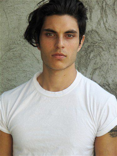Samuel Larsen. He looks good with or without dreadlocks.