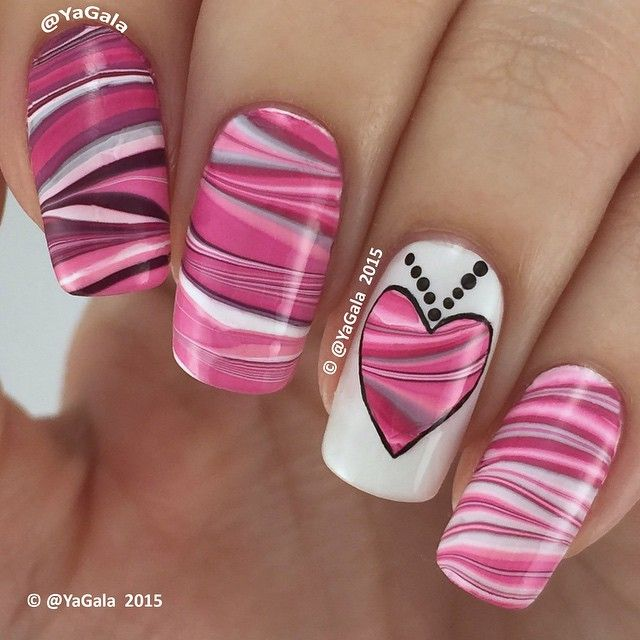 """Valentine's Day water marble I use @opi_products ""Alpine Snow"", ""Pink Friday"", ""Shorts Story"" and ""Casino Royale"" Fast drying top coat…"""