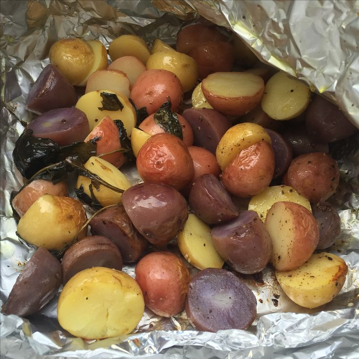 Benj did a fabulous job washing and cutting the potatoes. We drizzled them with olive oil, lots of basil, salt and pepper then wrapped them up for the BBQ.