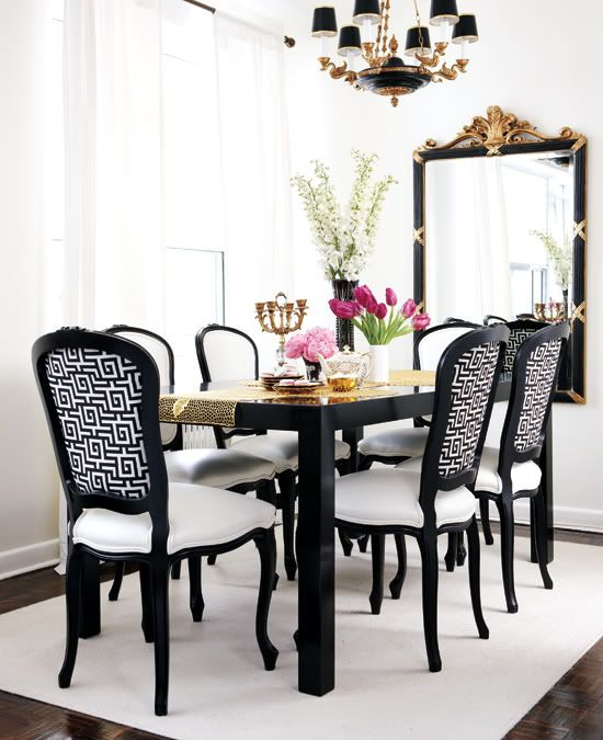 Glamorous Dining Room With Glossy Black Parsons Table French Chairs Upholstered In White Greek Key Fabric Leather Cushions