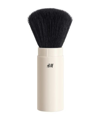 Natural white. A convenient, retractable brush for applying, blending and contouring with face powders, powder blush and bronzers.