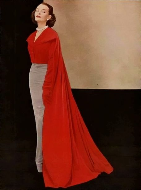 Love the sleek skirt and blouse and the sweep of the cape. Chic and dramatic. Balenciaga, 1949.