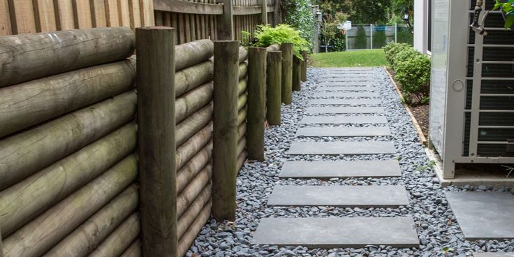 Earth Natural Garden Pebbles are matte charcoal pebbles and are formed from rumbled Granite pieces that marry up with any dark coloured pavers – from grey to black pavers.  #gardenpebbles #pebbles #stonepebbles
