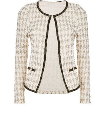 """Tenki. Add a subtle print to a work-wear outfit with this houndstooth jacket - try pairing with blue skinny jeans and a black cami.- All over houndstooth print- Simple long sleeves- Open front- Casual fit- Pocket front detail- Model is 5'8""""/176cm and wears UK 10/EU 38/US 6"""