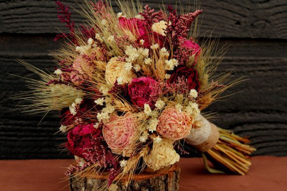 I love the colors of this bouquet. It brings in all of the main colors....sangria and petal rose bridesmaid dresses and rustic red/burgundy used in our signs, the venue, and the fall foliage. Rustic Burgundy And Pink Wedding Bouquet, Large Bridal Bouquet, Rustic Chic Bouquet, Dried Flowers, Peony Bouquet With Wheat & Wild Flowers