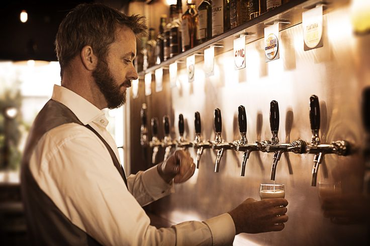 Our beer aficionado Andrew pouring from the freshly installed taps.