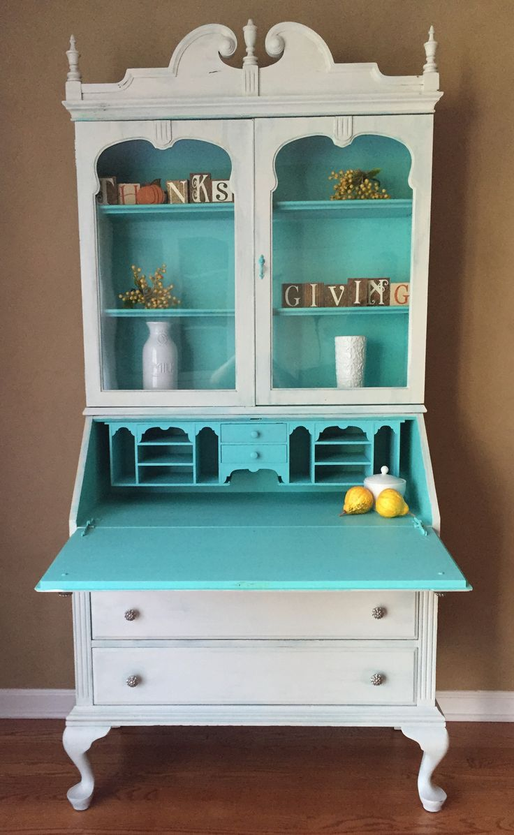 This restyled vintage Secretary is sure to get noticed this holiday season.  The cabinet is painted in a soft grey with teal highlights.  The finish is distressed and antiqued to add even more charm.   Dimensions are 36 wide x 18 deep x 77 tall. Offered at $490 plus tax.