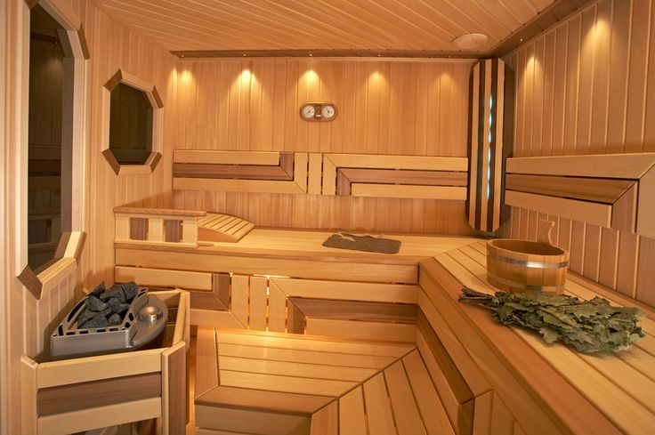 New sauna with L-shape using two tones of wood for a more intricate interior sauna design.