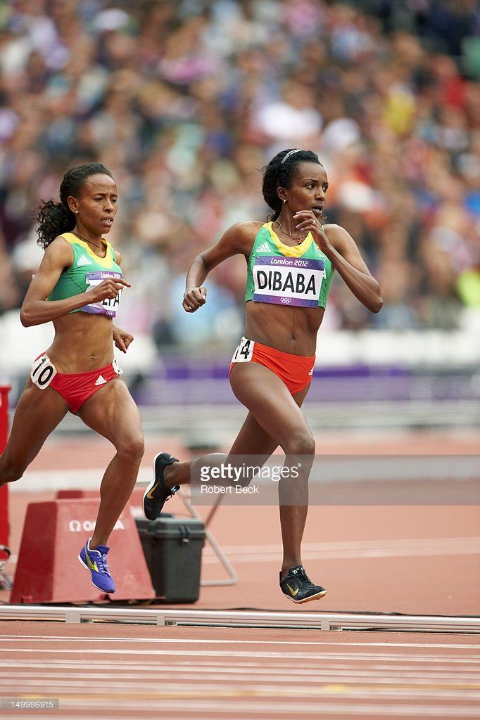 Ethiopia Tirunesh Dibaba in action during Women's 5000M Round 1 at Olympic Stadium. Robert Beck X155162 TK4 R1 F206 )