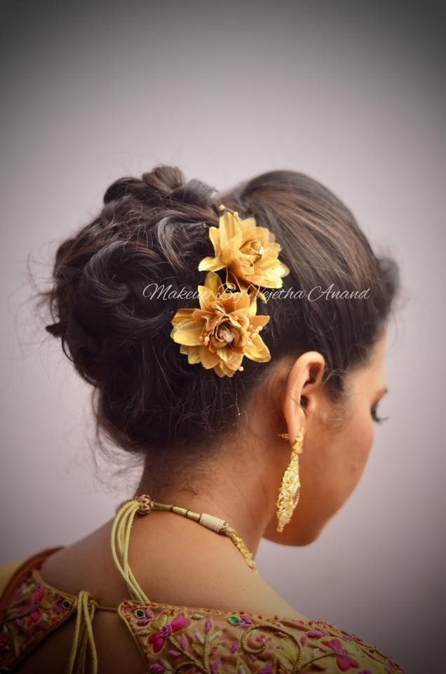 Indian bride's reception hairstyle by Swank Studio. Bridal