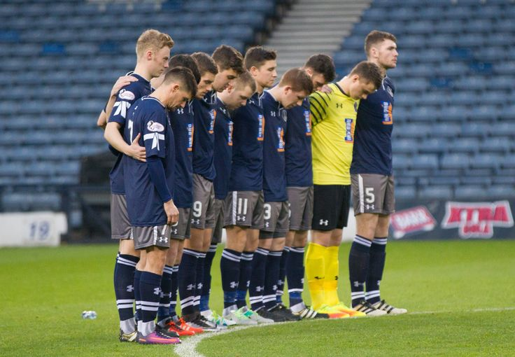 Queen's Park's players observe a minute's silence before the Ladbrokes League One game between Queen's Park and Brechin City.