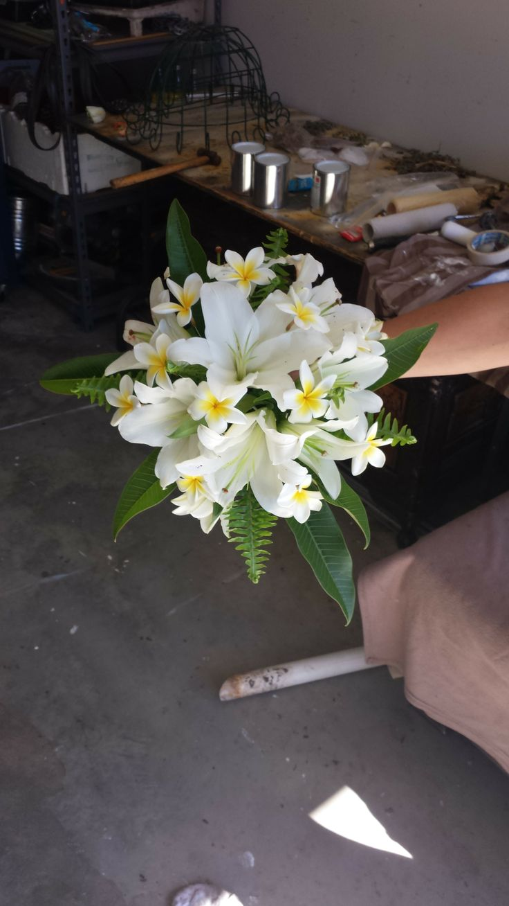 wedding white oriental lillies and frangapani's with greenery...