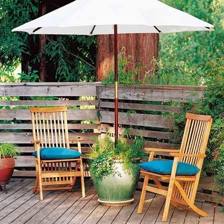 Plant an umbrella base - If you have an umbrella, but are in need of a base, this is an ingenious idea. Using a glazed ceramic pot and piece of pipe, add concrete mix in the middle and then soil on top, and voila! You have a decorative umbrella base.