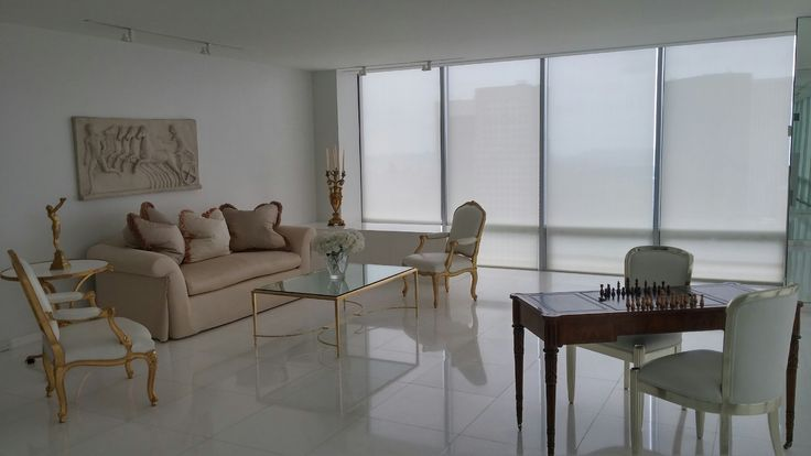 Motorized roller shades by NY City Blinds adorn the windows of this New York City living room.