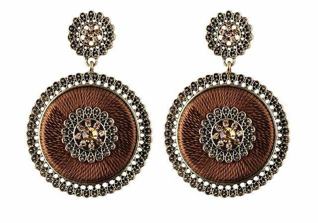 Bronze coloured earrings.