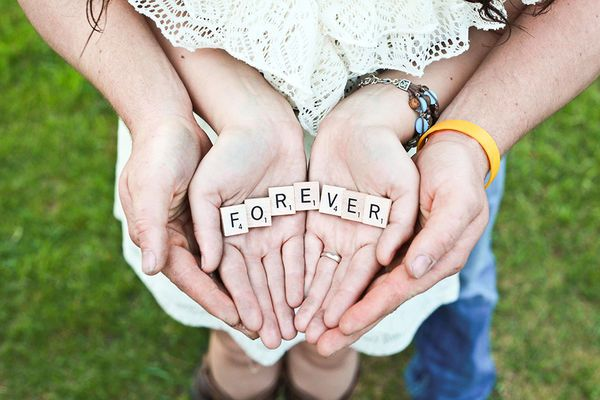 Cute engagement photo with Scrabble tiles. Perfect for a save the date.