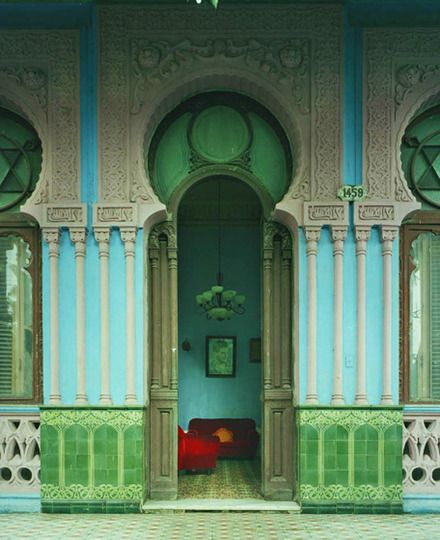 Cuba........  The landscape of Michael Eastman's photographs is lush, organic and green, but the subject matter is the rotting interior of buildings. The botanical elements of a traditional still-life are replaced by the wild overgrowth of patinaed and tattered walls teetering on the edge of a by-gone era.