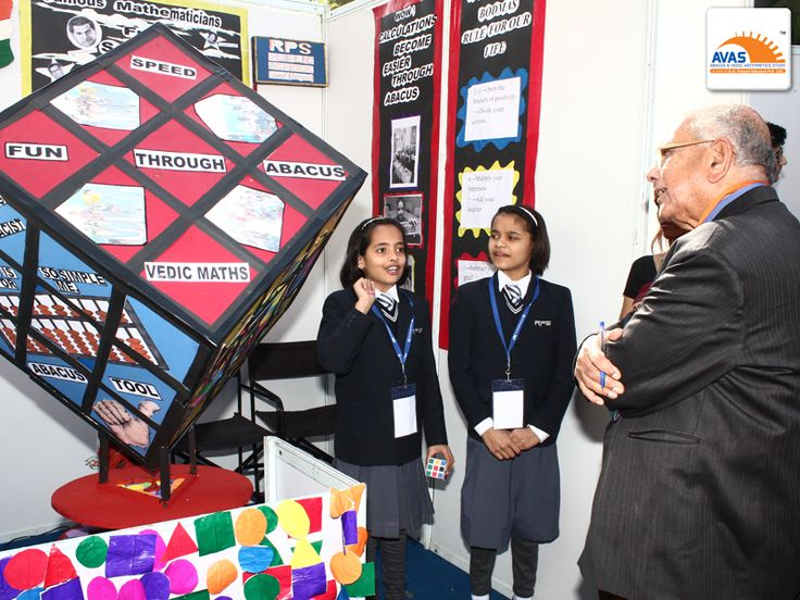 Mr S K Bhattacharya, one of the judge in panel at national Symposium, organized by avasindia at IIT Delhi, taking a round of Maths exhibition and judging the stall of RPS Rewari.