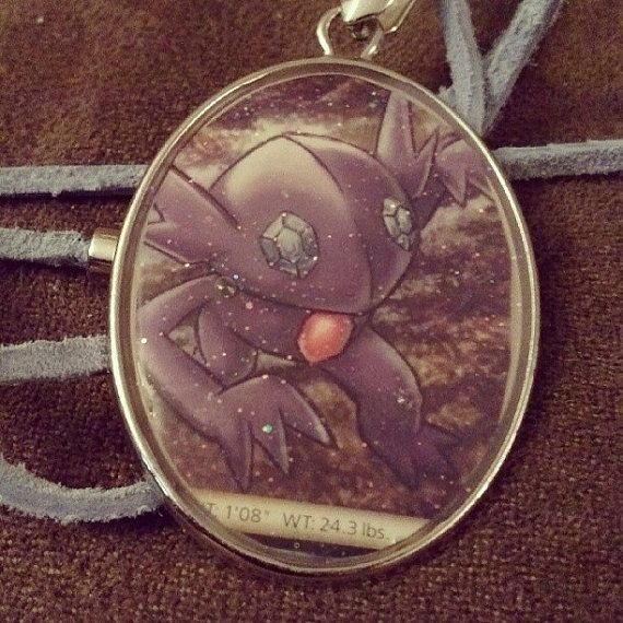 Hey, I found this really awesome Etsy listing at https://www.etsy.com/listing/181675320/sableye-pokemon-card-necklace