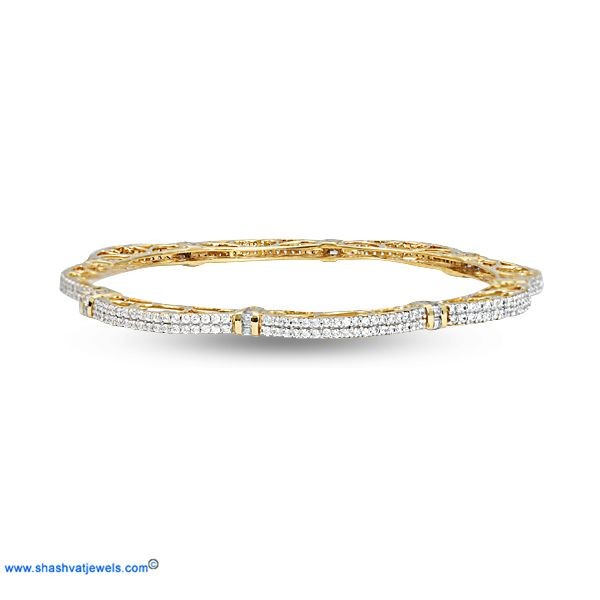 The wave bangle with sparkling diamonds; the wave diamond bangle is a complete stunner. Add some glamor to your regular outfits by pairing with hoop earrings. Every women must have! #diamond #bangle #for #her http://www.shashvatjewels.com/ProductDetail.aspx?prdid=899&name=The%20Wave%20Bangle All our designs are available in white gold & silver