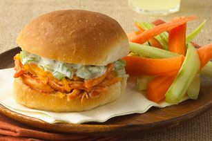 Buffalo Chicken Party Sandwiches recipe - You get the crunch of celery, the heat of sauce and the cool of blue cheese in a bun with Buffalo chicken, minus the messy fingers you get with wings.