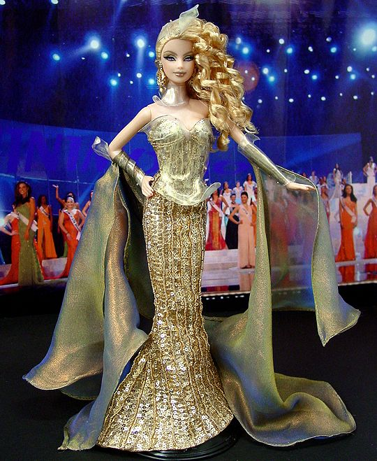 This one makes me think of a golden goddess. Ninimomo Miss Denmark 2011 ooak barbie