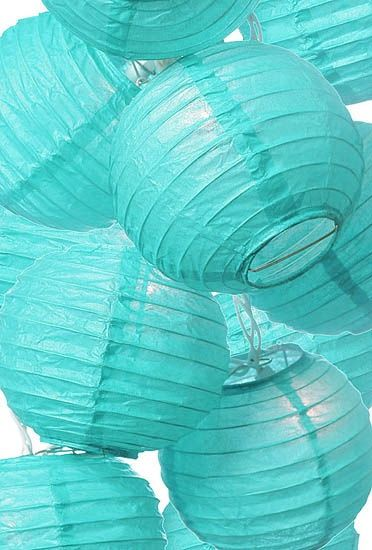 Pretty turquoise paper lanterns #paperlanterns #wedding