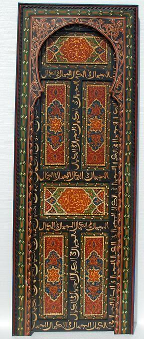 Africa | ' Mazagan door' Painted cedar door, Arabic calligraphy, all handmade in Marrakesh | currently being sold by Casbah Decor.