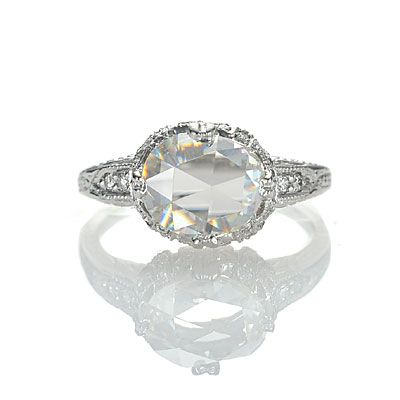 Art Deco Ring US $6,575 Stock #3097-23 Oval rose cut diamond, 1.19 carats, K color and SI1 clarity, set in platinum with 32 round bead set diamonds with hand engraved detailing.